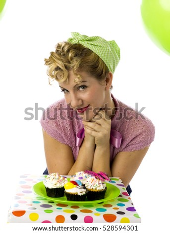 retro woman birthday celebration with balloons and cupcakes