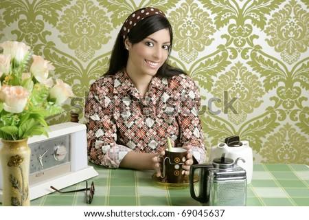 Retro woman drinking coffee on kitchen vintage wallpaper - stock photo