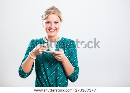 Retro woman enjoys in cup of tea.Tea time - stock photo