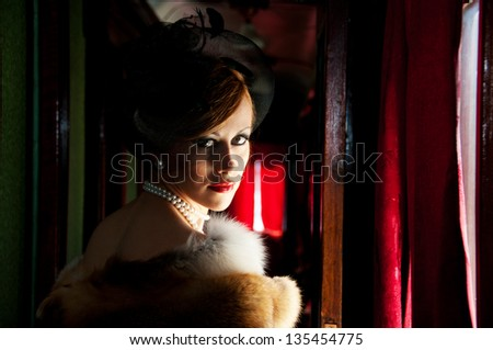 Retro Woman in hat with veil and fox furs - stock photo