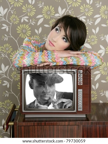 retro woman in love with tv african hero [Photo Illustration] - stock photo