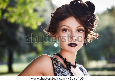Retro Woman Portrait. Beautiful Woman. Vintage Styled Photo. Old Fashioned Makeup and Finger Wave Hairstyle. 20`s or 30`s style - stock photo