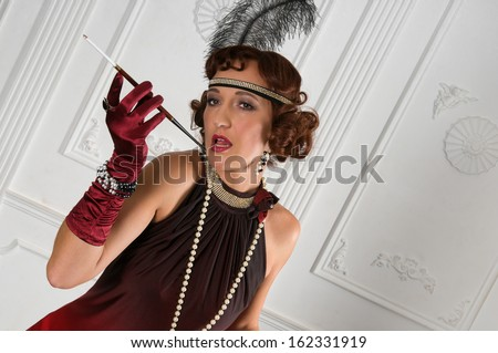 Retro Woman Portrait. Beautiful Woman with Mouthpiece. Cigarette - stock photo