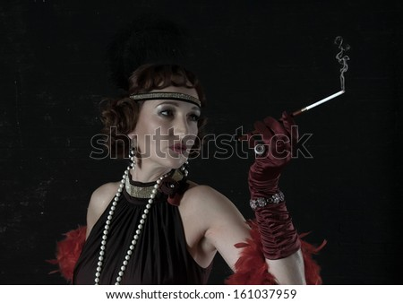 Retro Woman Portrait. Beautiful Woman with Mouthpiece. Smokes - stock photo