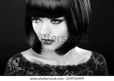 Retro woman portrait. Fashion model girl face. Bob hairstyle. Black and white photo. - stock photo