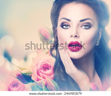 Retro woman portrait in beauty pink roses. Beautiful Vintage styled girl with flowers. Perfect makeup and hairstyle. Gorgeous model lady. Red Lips. Luxury Make up and Hair. Vogue Style - stock photo