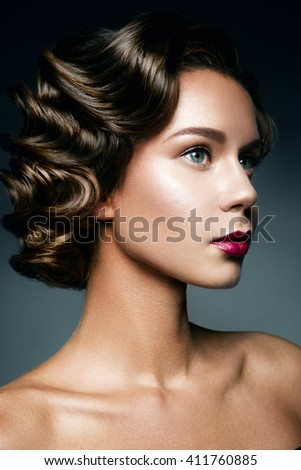 Retro Woman Portrait with beautyful hairstyle and make up. - stock photo