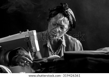 Retro woman sewing and smoking cigarettes