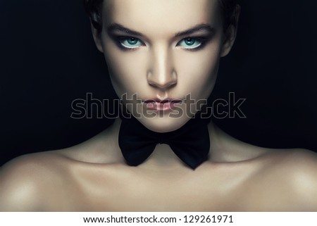 retro woman with black tie bow on neck - stock photo