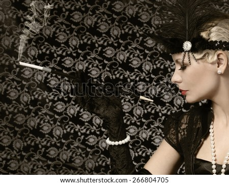 Retro Woman with Cigar. Vintage style. Portrait of Fashion Beautiful Blonde.  - stock photo
