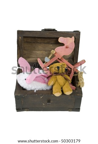 Retro wooden toy chest with metal straps filled with antique toys - path included - stock photo
