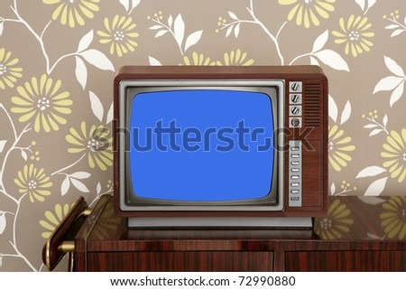 retro wooden tv on wooden vintage 60s furniture floral wallpaper [Photo Illustration] - stock photo
