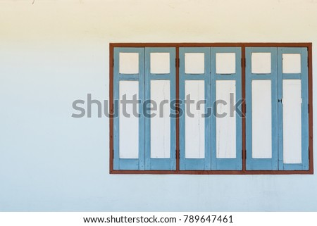 Retro wooden window on walls of the house with space. use for background