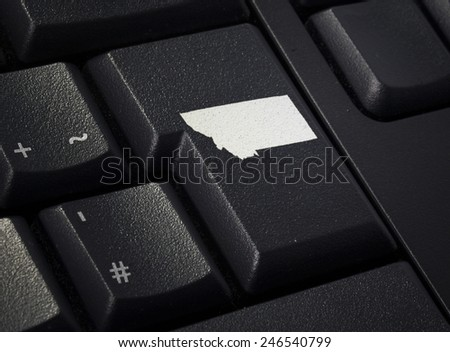 Return key in the shape of Montana.(series) - stock photo