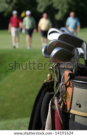 RETURNING GOLFERS - stock photo