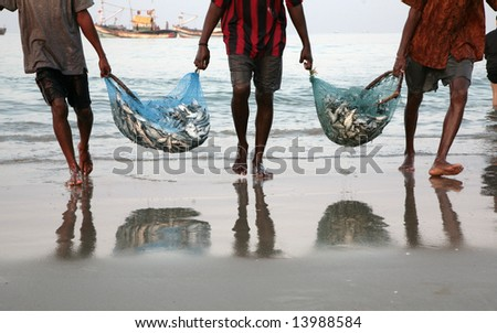 returning home of fishermen with catch - stock photo