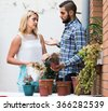 Returning russian wife in shock of husband and shrunken plants - stock photo