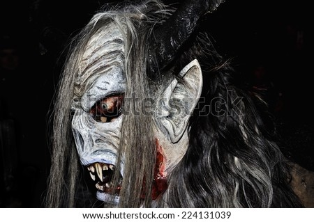 RETZ, AUSTRIA - DECEMBER 7: Unidentified man wears devil mask at traditional procession on December 7, 2013 in Retz, Austria. - stock photo