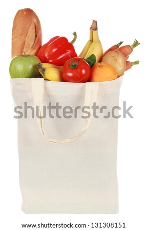 Reusable bag with groceries including a bread, fruits and vegetables, isolated on white - stock photo