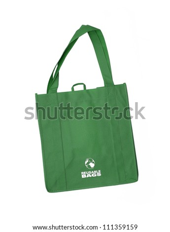 Reusable green shopping bag with recycle symbol isolated on white background - stock photo