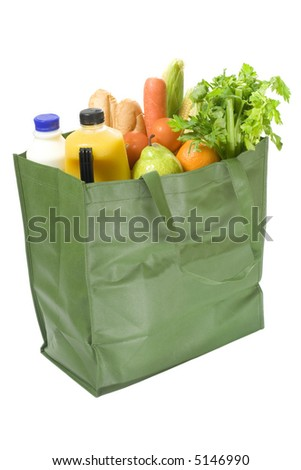 Reusable shopping bag full of groceries isolated on white background - stock photo