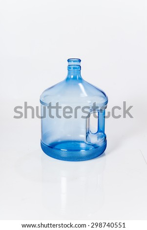 Reusable standard five-gallon plastic water bottle for cooler white background - stock photo