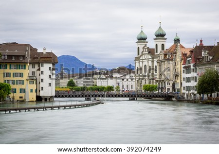 Reuss river in Lucerne, Switzerland with high water, long exposure - stock photo
