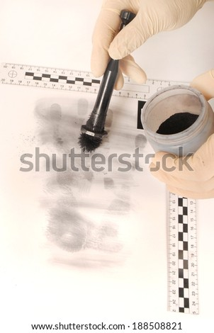 Revealing and preserving the fingerprints- investigation of the scene - stock photo