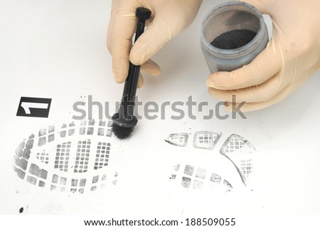 revealing and preserving the shoe print-investigation  - stock photo