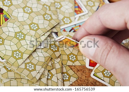 Revealing tarot card - stock photo