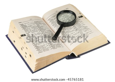 Revealling book with magnifying glass - stock photo