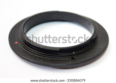 Reverse adapter for lens on the white background.