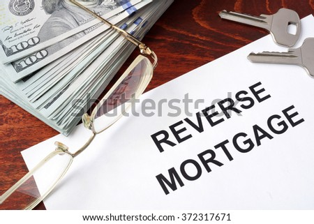 Reverse mortgage form on a table and money. - stock photo