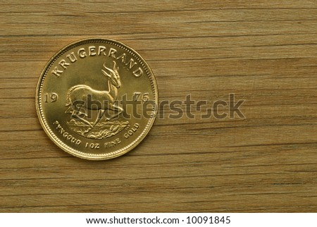 Reverse of gold South African Krugerrand coin, one ounce pure gold - stock photo