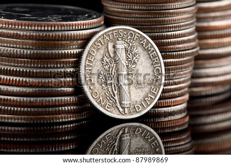 Reverse of USA coin, the 1940 Winged Liberty Head Mercury Dime, depiction of Liberty wearing a Phrygian cap, a classic symbol of liberty and freedom - stock photo