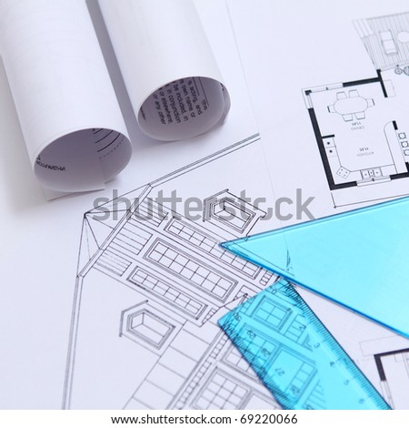 Reviewing a blueprint - stock photo