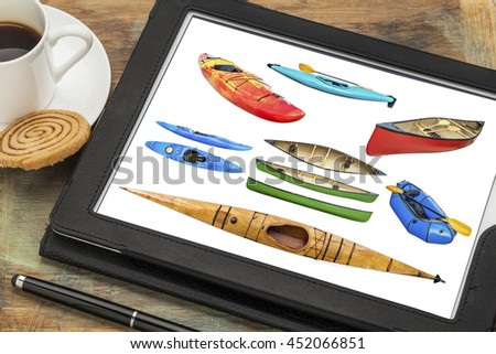Reviewing isolated pictures of paddling boats (kayak, canoe, raft) on a tablet with cup of coffee. All screen images copyright by the photographer and included at high resolution in the portfolio. - stock photo
