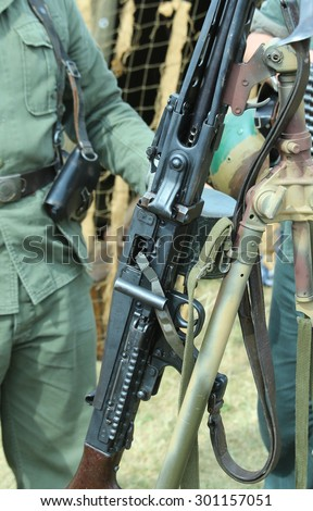 Revolutionary Army armed guard with a big gun - stock photo