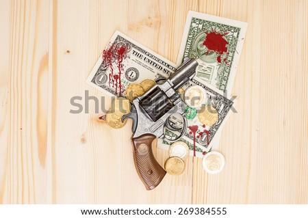 Revolver and blood money - stock photo
