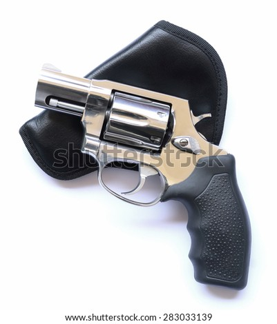 Revolver gun placed on Leather Case on white background - stock photo