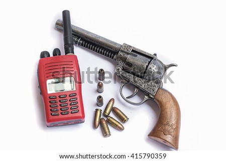 Revolver gun with cartridges,Radio communication isolated on white background. - stock photo