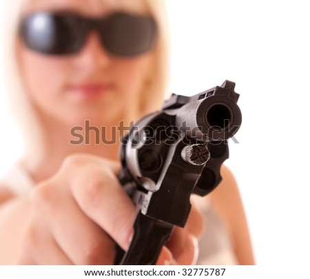 Revolver in hands of sexy woman isolated on white - stock photo