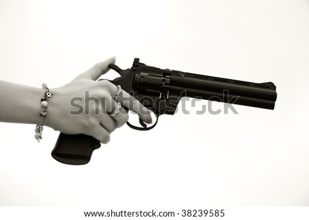 revolver in the woman's hand, bw - stock photo