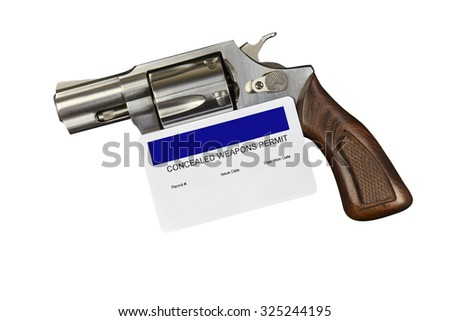 Revolver with CCW Gun Permit Isolated on White Background. Closeup. Studio Props. No Releases Needed. - stock photo
