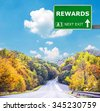 REWARDS road sign against clear blue sky - stock photo