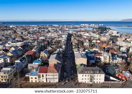 Reykjavik city overview shot from the tower of hallgrimskirkja over to the downtown area and shopping street of laugavegur - stock photo