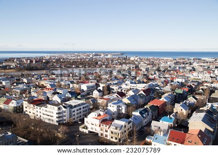 Reykjavik city overview shot from the tower of hallgrimskirkja over to the downtown area and the pond in the center of town - stock photo