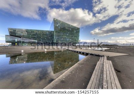REYKJAVIK, ICELAND - AUGUST 5: Harpa concert hall on August 5, 2012 in Rejkjavik, Iceland. Harpa is a concert hall in Reykjavi�­k, Iceland. The opening concert was held on May 4, 2011. - stock photo