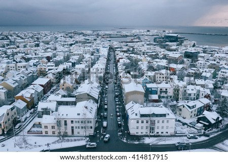 REYKJAVIK, ICELAND - CIRCA DECEMBER 2015: Rooftop view of Reykjavik city center, seen from the observation tower of Hallgrimskirkja church on a grey winter day.