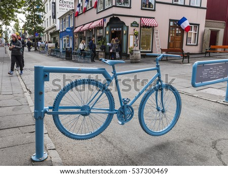 Reykjavik, Iceland - July 8, 2016: Shopping street Laugavegur in Reykjavik Iceland, with people, terrace and blue bicycle.